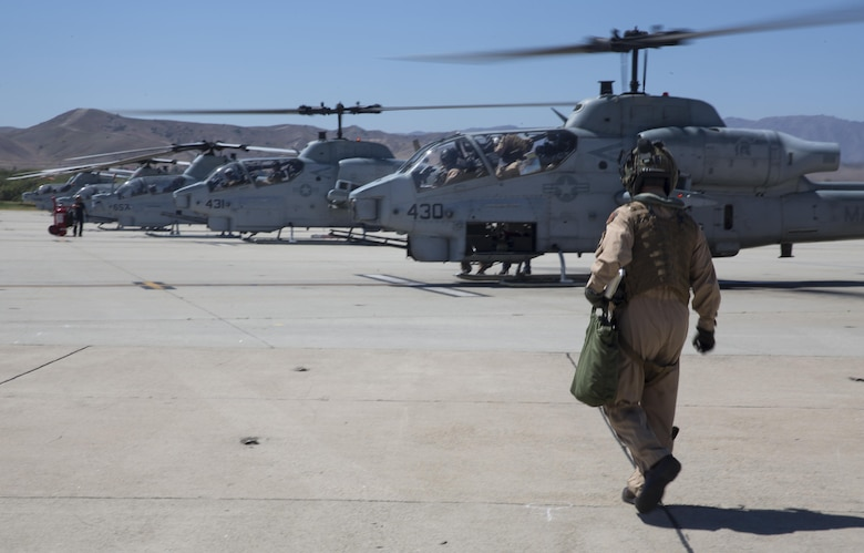 Maj. Gen. Michael Rocco, commanding general of 3rd Marine Aircraft Wing, heads to an AH-1W Super Cobra to begin his last flight aboard Marine Corps Air Station Camp Pendleton, Calif., July 7, 2016. Rocco took command of 3rd MAW in June 2014 and is slated to relinquish command to Maj. Gen. Mark Wise on July 22, 2016. (U.S. Marine Corps photo by Pfc. Jake McClung/Released)