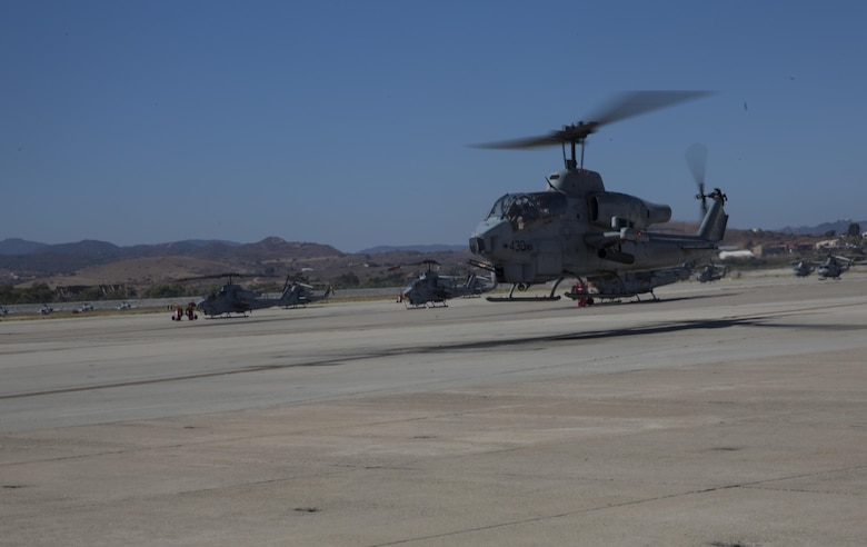 Maj. Gen. Michael Rocco, commanding general of 3rd Marine Aircraft Wing, takes off in an AH-1W Super Cobra during his last flight aboard Marine Corps Air Station Camp Pendleton, Calif., July 7, 2016. Rocco took command of 3rd MAW in June 2014 and is slated to relinquish command to Maj. Gen. Mark Wise on July 22, 2016. (U.S. Marine Corps photo by Pfc. Jake McClung/Released)