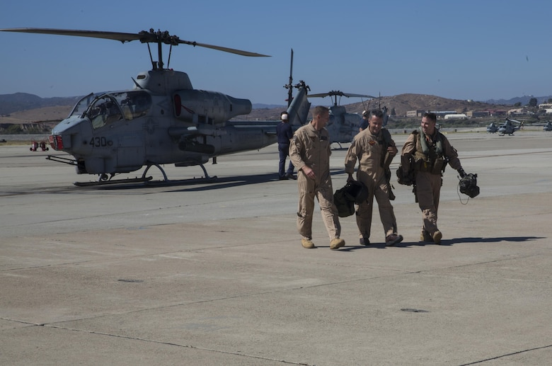 Maj. Gen. Michael Rocco (center), commanding general of 3rd Marine Aircraft Wing, Col. Michael Borgschulte (left), commanding officer of Marine Aircraft Group (MAG) 39, and an AH-1W Super Cobra pilot with Marine Light Attack Helicopter Training Squadron 303, walk away from a Cobra after Rocco's last flight aboard Marine Corps Air Station Camp Pendleton, Calif., July 7, 2016. Rocco took command of 3rd MAW in June 2014 and is slated to relinquish command to Maj. Gen. Mark Wise on July 22, 2016. (U.S. Marine Corps photo by Pfc. Jake McClung/Released)