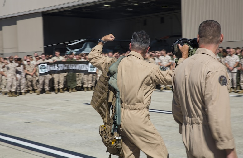 Maj. Gen. Michael Rocco, commanding general of 3rd Marine Aircraft Wing, flexes at the Marines of Marine Aircraft Group (MAG) 39 after his last flight aboard Marine Corps Air Station Camp Pendleton, Calif., July 7, 2016.  Rocco returned to every Marine in MAG-39 waiting for him on the flight line to show appreciation for his hardwork and great leadership during his two-year tour with 3rd MAW. (U.S. Marine Corps photo by Pfc. Jake McClung/Released)