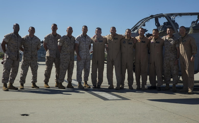 Maj. Gen. Michael Rocco, commanding general of 3rd Marine Aircraft Wing, poses for a picture with leaders from Marine Aircraft Group (MAG) 39 after his last flight aboard Marine Corps Air Station Camp Pendleton, Calif., July 7, 2016. Rocco took command of 3rd MAW in June 2014 and is slated to relinquish command to Maj. Gen. Mark Wise on July 22, 2016. (U.S. Marine Corps photo by Pfc. Jake McClung/Released)