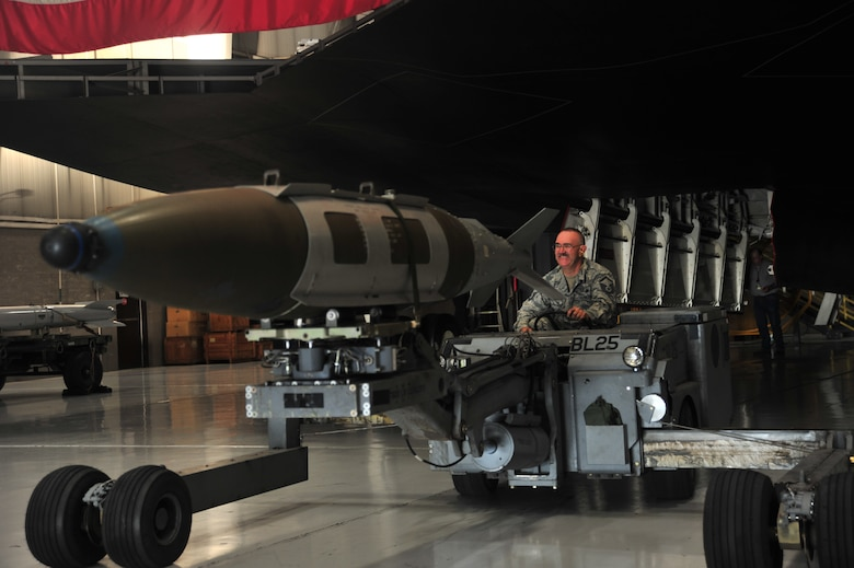 U.S. Air Force Master Sgt. Allen Anderson, an aircraft armament systems mechanic assigned to the 131st Aircraft Maintenance Squadron, operates an MHU-83 D/E jammer  during certification training at Whiteman Air Force Base, Mo., June 28, 2016. Anderson, after serving more than 20 years in the Air Force, decided to end his career how it began, as a weapons loader.  (U.S. Air Force photo by Senior Airman Jovan Banks)