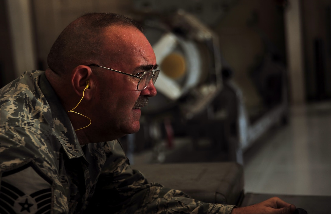 U.S. Air Force Master Sgt. Allen Anderson, an aircraft armament systems mechanic assigned to the 131st Aircraft Maintenance Squadron, loads a GBU–31 version 1 trainer munition during certification training at Whiteman Air Force Base, Mo., June 28, 2016. Anderson holds the four man role on his load crew team, which gives him control of the jammer during munition loads. (U.S. Air Force photo by Senior Airman Jovan Banks)
