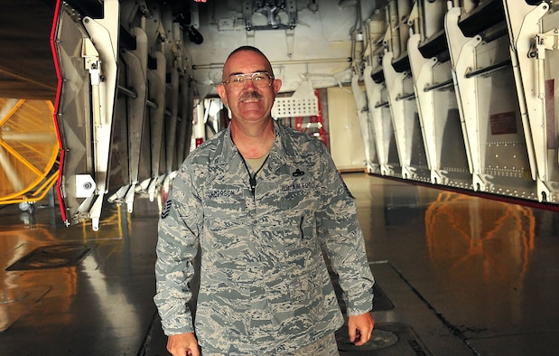 U.S. Air Force Master Sgt. Allen Anderson, an aircraft armament systems mechanic assigned to the 131st Aircraft Maintenance Squadron, smiles after successfully completing steps for his certification training at Whiteman Air Force Base, Mo., June 28, 2016. Anderson is certified to load various munitions and now holds the four man role on his load crew. (U.S. Air Force photo by Senior Airman Jovan Banks)