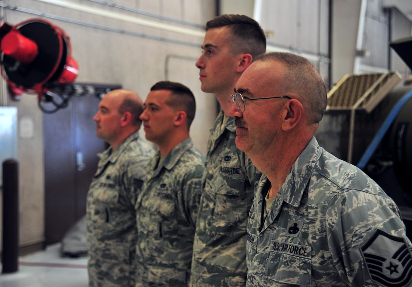 U.S. Air Force Master Sgt. Allen Anderson, an aircraft armament systems mechanic assigned to the 131st Aircraft Maintenance Squadron, stands beside the rest of his load crew prior to certification training at Whiteman Air Force Base, Mo., June 28, 2016. Airmen must be certified on each training munition before being allowed to load it onto aircraft. (U.S. Air Force photo by Senior Airman Jovan Banks)