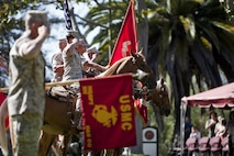 A U.S. Marine Corps mounted color guard presents the colors during a change of command ceremony for Marine Corps Installations West-Marine Corps Base, Camp Pendleton, at the Santa Margarita Ranch House National Historic Site on Camp Pendleton, Calif., July 15, 2016. (U.S. Marine Corps photo by Cpl. Brian D. Bekkala)
