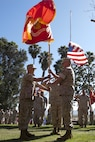 U.S. Marine Corps Brig. Gen. Edward D. Banta, right, commanding general, Marine Corps Installations West-Marine Corps Base, Camp Pendleton, relinquishes his command by the passing of the colors to U.S. Marine Corps Brig. Gen. Kevin J. Killea during their change of command ceremony at the Santa Margarita Ranch House National Historic Site on Camp Pendleton, Calif., July 15, 2016. (U.S. Marine Corps photo by Cpl. Brian D. Bekkala)