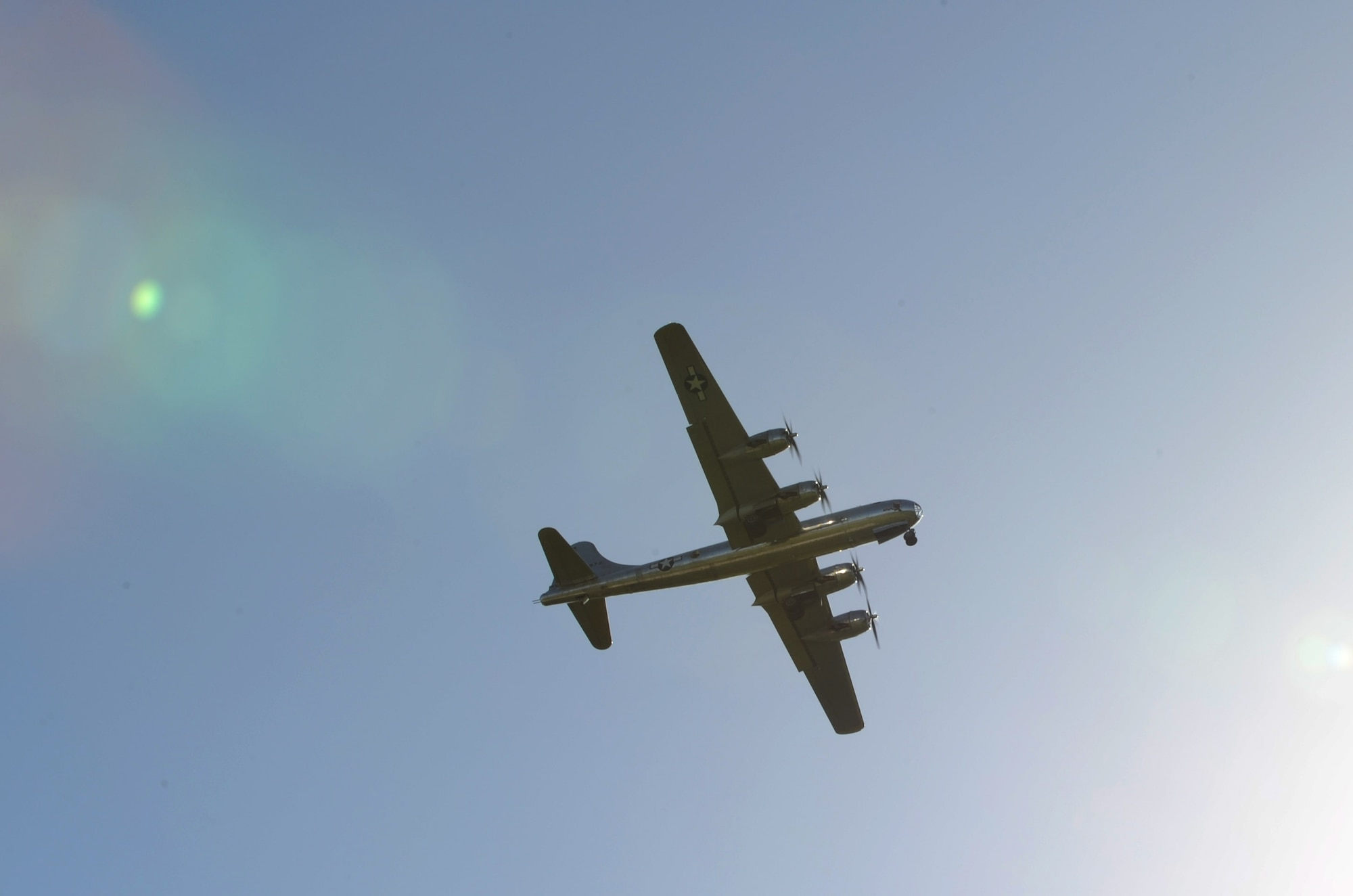 A B-29 Superfortress, known as 'Doc,' flies over McConnell Air Force Base Kan., July 17, 2016. This was the aircraft's first flight after being used by the U.S. Navy for target training in the Mojave Desert for 42 years. (U.S Air Force photo/)