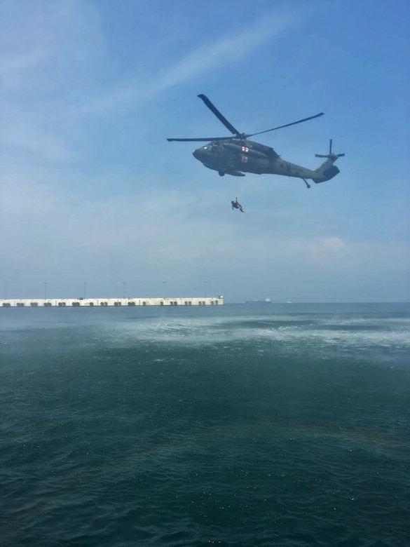 Members of the 1st Battalion, 228th Aviation Regiment from Joint Task Force-Bravo and Special Operations Command South conduct open water rescue training with Salvadorian military using an HH-60 Black Hawk Medical Evacuation helicopter May 26 in El Salvador. Salvadorian military members received incremental training that began with helicopter familiarization and progressed to rappelling from, and being hoisted into, the 1-228th AVN's Black Hawks flying at heights of up to 90 feet. JTF-Bravo and other U.S. Military elements such as U.S. Army South Regionally Aligned Forces and Special-Purpose Marine Air, Ground Task Forces, under the auspices of U.S. Southern Command, routinely conduct combined training and exercises with Partner Nation security forces in multiple Central American nations, improving the safety and security in the CENTAM region and southern approaches to the United States. (Courtesy Photo)