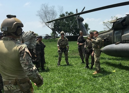 Members of the 1st Battalion, 228th Aviation Regiment from Joint Task Force-Bravo and Special Operations Command South conduct aircraft familiarization training on a UH-60 Black Hawk helicopter with Salvadorian military May 24 in El Salvador. JTF-Bravo and other U.S. Military elements such as U.S. Army South Regionally Aligned Forces and Special-Purpose Marine Air, Ground Task Forces, under the auspices of U.S. Southern Command, routinely conduct combined training and exercises with Partner Nation security forces in multiple Central American nations, improving the safety and security in the CENTAM region and southern approaches to the United States. (Courtesy Photo  Illustration)