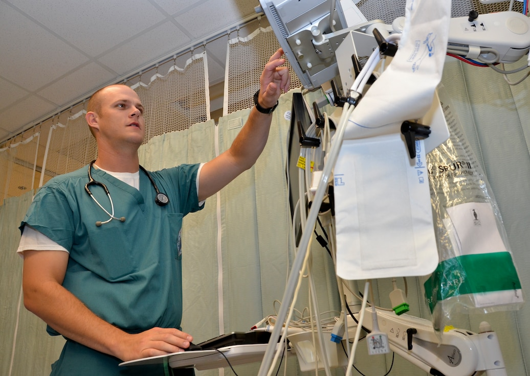 2nd Lt. Zachary Mabeus, nurse, 117th Medical Group, prepares a room for a patient at Naval Medical Center San Diego, in San Diego, Calif., June 29, 2016.  The 117 MDG trained with the U.S. Navy at Naval Medical Center San Diego.  The training included Airmen being implemented in real world U.S. Naval operations.  (U.S. Air National Guard photo by Staff Sgt. Jeremy Farson/Released)