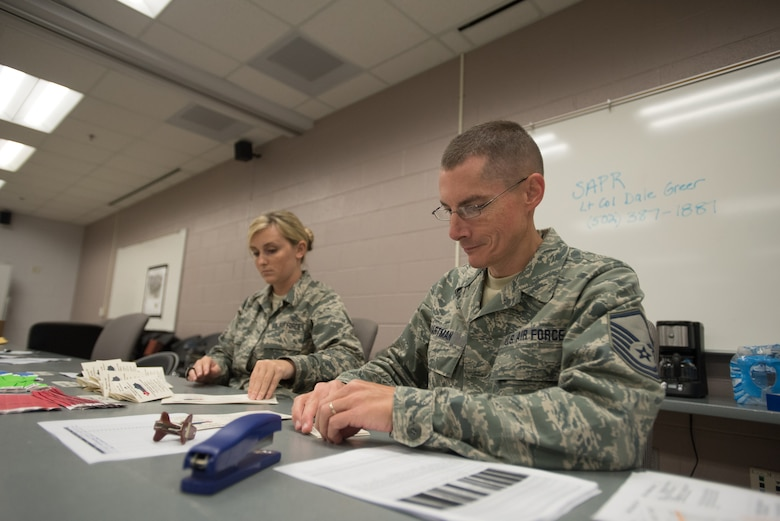 Master Sgt. Don Hartman (right) and Staff Sgt. Kayla Holt, personnel support specialists for the Kentucky Air National Guard's 123rd Force Support Squadron, wait to in-process military members at Barkley Regional Airport in Paducah, Ky., July 16, 2016, in preparation for Bluegrass Medical Innovative Readiness Training. The program will offer medical and dental care at no cost to residents in three Western Kentucky locations from July 18 to 27. (U.S. Air National Guard photo by Master Sgt. Phil Speck)