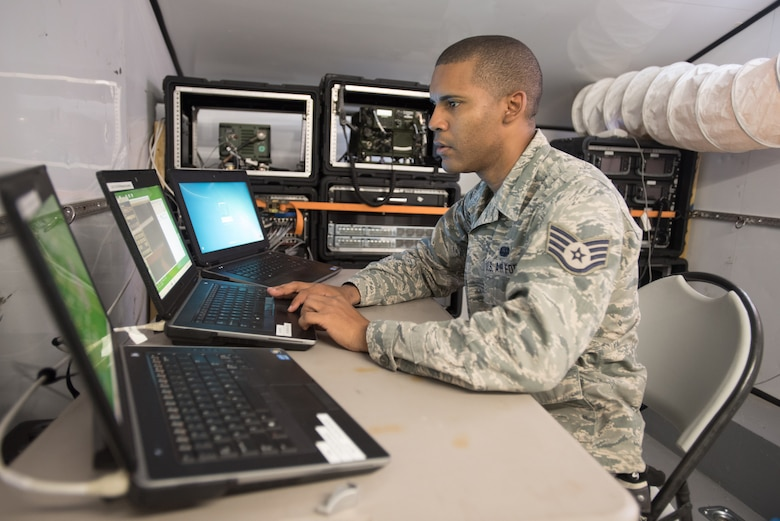 Staff Sgt. Jose Romero, a cyber systems operations technician for the Puerto Rico Air National Guard's 156th Airlift Wing, sets up satellite communications at Paducah Tilghman High School in Paducah, Ky., July 16, 2016, in preparation for Bluegrass Medical Innovative Readiness Training. The program will offer medical and dental care at no cost to residents in three Western Kentucky locations from July 18 to 27. (U.S. Air National Guard photo by Master Sgt. Phil Speck)