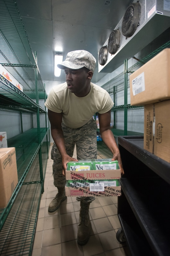 Staff Sgt. Marcus Roberts, food services specialist for the New Jersey Air National Guard's 108th Force Support Squadron, stores incoming food supplies in a walk-in cooler to feed military members that will support Bluegrass Medical Innovative Readiness Training at Carlisle County High School in Bardwell, Ky., July 14, 2016. The program will offer medical and dental care at no cost to residents in three Western Kentucky locations from July 18 to 27. (U.S. Air National Guard photo by Master Sgt. Phil Speck)