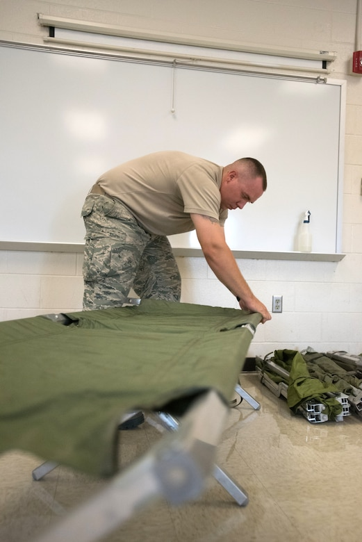 Tech. Sgt. Cody McNaughton, food services specialist for the New Jersey Air National Guard's 108th Force Support Squadron, prepares cots for military members that will support Bluegrass Medical Innovative Readiness Training at Carlisle County High School in Bardwell, Ky., July 14, 2016. The program will offer medical and dental care at no cost to residents in three Western Kentucky locations from July 18 to 27. (U.S. Air National Guard photo by Master Sgt. Phil Speck)
