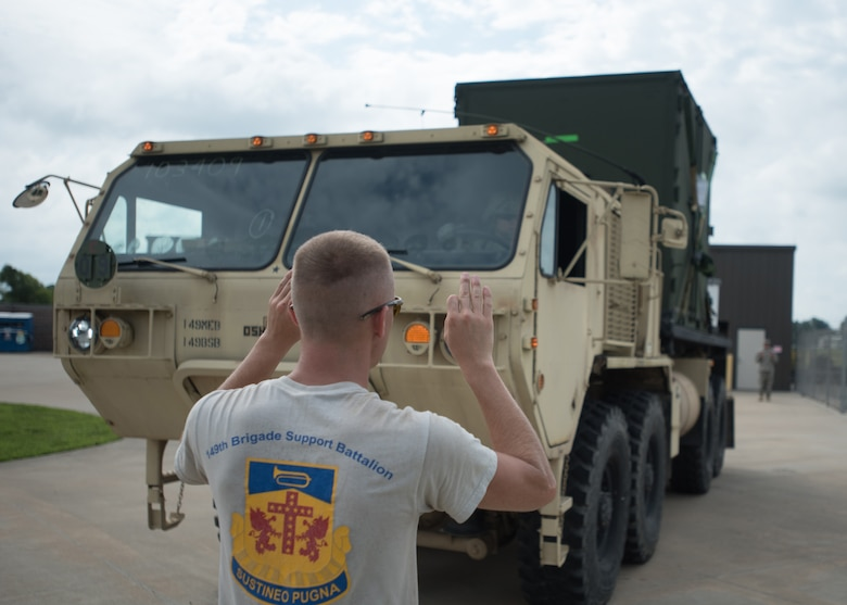 Kentucky Army National Guard Sgt. Joseph Foriest, a transportation specialist for the 149th Brigade Support Battalion, directs a U.S. Army Load Handling System at Barkley Regional Airport in Paducah, Ky., July 14, 2016, in preparation for Bluegrass Medical Innovative Readiness Training. The program will offer medical and dental care at no cost to residents in three Western Kentucky locations from July 18 to 27. (U.S. Air National Guard photo by Master Sgt. Phil Speck)