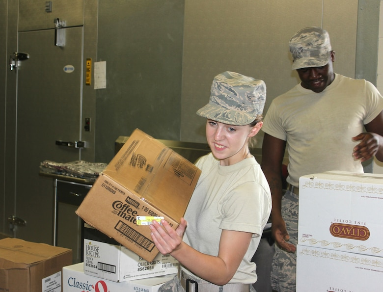 Airman First Class Katie Wainwright and Staff Sgt. Marcus Roberts, food services personnel in the New Jersey Air National Guard's 108th Force Support Squadron, organize food supplies at Carlisle County High School in Bardwell, Ky., July 14, 2016. The Kentucky Air National Guard and the U.S. Navy Reserve will provide medical and dental care at no cost to residents in three Western Kentucky locations from July 18 to 27 as part of Bluegrass Medical Innovative Readiness Training, a program co-sponsored by the U.S. Department of Defense and the Delta Regional Authority. (U.S. Navy Reserve photo by Petty Officer 2nd Class Cathan Bricker)