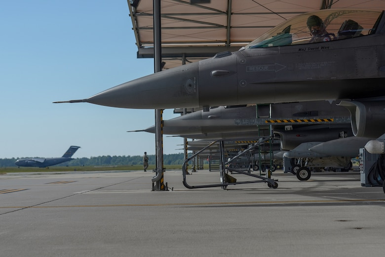 U.S. Air Force Capt. Mark Fattman, an F-16 fighter pilot assigned to the 169th Fighter Wing, South Carolina Air National Guard, performs a pre-flight inspection at Mc McEntire Joint National Guard Base, S.C., July 11, 2016. Approximately 300 U.S. Airmen and 12 F-16 Fighting Falcon jets from the 169th Fighter Wing at McEntire JNGB, S.C., are deploying to Osan Air Base, Republic of Korea, as the 157th Expeditionary Fighter Squadron in support of the U.S. Pacific Command Theater Security Package. (U.S. Air National Guard photo by Airman 1st Class Megan Floyd)