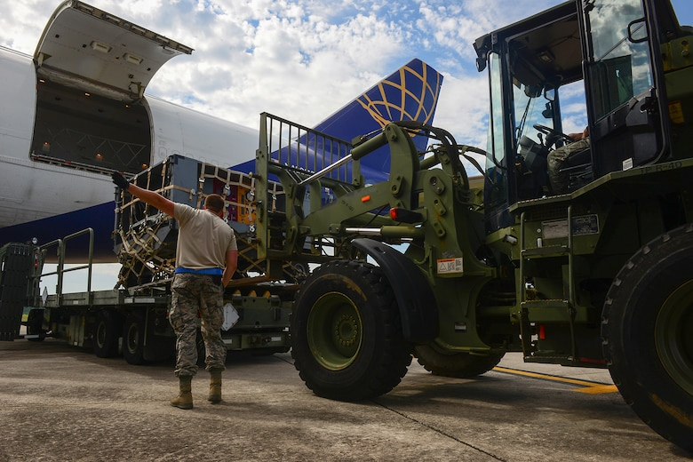 U.S. Air Force Tech. Sgt. Josh Williams, an air transportation specialist assigned to the 169th Logistics Readiness Squadron, guides a forklift carrying cargo at McEntire Joint National Guard Base, S.C., July 8, 2016. Approximately 300 U.S. Airmen and 12 F-16 Fighting Falcon jets from the 169th Fighter Wing at McEntire JNGB, S.C., are deploying to Osan Air Base, Republic of Korea, as the 157th Expeditionary Fighter Squadron in support of the U.S. Pacific Command Theater Security Package. (U.S. Air National Guard photo by Airman 1st Class Megan Floyd)