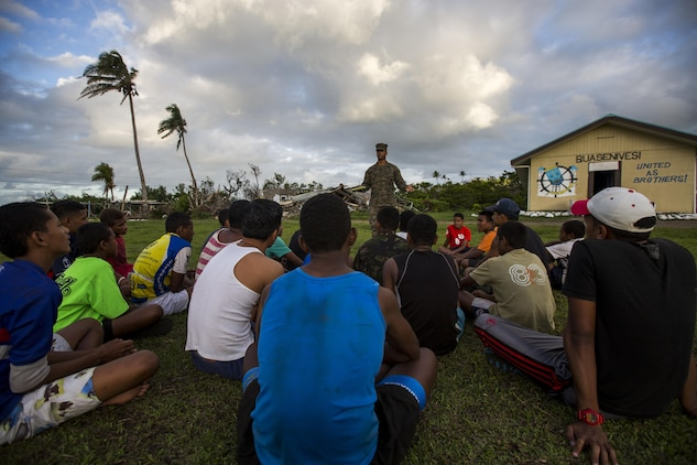 U.S. Navy Petty Officer 2nd Class Corey J. Buchanan, Hospital Corpsman with Task Force Koa Moana 16.2, leads small instructions on general health and wellness to local youth at St. John's College, Ovalau, Fiji, July 12, 2016. Fiji is part of Task Force Koa Moana's deployment throughout the Asia-Pacific region where Marines and Sailors will share engineering and infantry skills with the Republic of Fiji Military Forces to strengthen mil-to-mil relationships and interoperability. (U.S. Marine Corps imagery by MCIPAC Combat Camera Lance Cpl. Jesus McCloud/ Released)