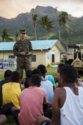U.S. Navy Hospitalman John J. Bustamante, Preventive Medicine Technician with Task Force Koa Moana 16.2, leads small instructions on general health and wellness to local youth at St. John's College, Ovalau, Fiji, July 12, 2016. Fiji is part of Task Force Koa Moana's deployment throughout the Asia-Pacific region where Marines and Sailors will share engineering and infantry skills with the Republic of Fiji Military Forces to strengthen mil-to-mil relationships and interoperability. (U.S. Marine Corps imagery by MCIPAC Combat Camera Lance Cpl. Jesus McCloud/ Released)