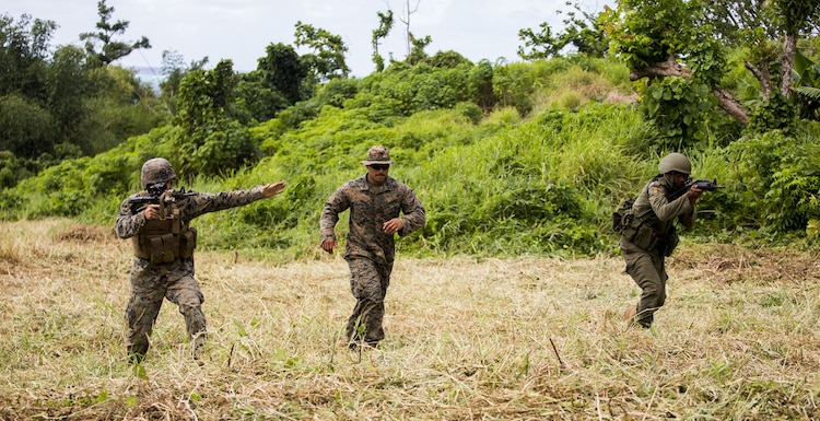 U.S. Marine Lance Cpl. Noah A. Bigbee, with Task Force Koa Moana 16.2, and Republic of Fiji Military Forces Pvt. Iliesa Naqovu conduct integrated fire-team buddy rushes on Ovalau, Fiji, July 13, 2016. Fiji is part of Task Force Koa Moana's deployment throughout the Asia-Pacific region, where Marines and Sailors will share engineering and infantry skills with the RFMF to strengthen mil-to-mil relationships and interoperability. (U.S. Marine Corps imagery by MCIPAC Combat Camera Lance Cpl. Jesus McCloud/ Released)