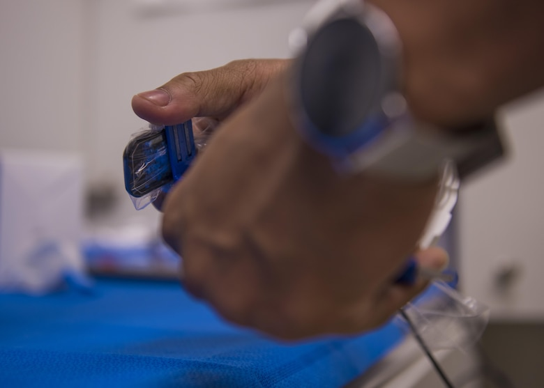 U.S. Army Specialist Anfernee Grant, 129th Area Support Medical Company dental technician, prepares a periapical X-ray device, Bagram Airfield, Afghanistan, July 16, 2016. X-rays are used as a tool to help detect decay or abscess in the root of the gums. (U.S. Air Force photo by Senior Airman Justyn M. Freeman)
