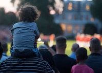 Guests observe as the United States Marine Band performs during the Evening Parade at Marine Barracks Washington, D.C., July 15, 2016. The guest of honor for the parade was the Honorable John Cornyn, United States Senator for Texas, and the hosting official for the evening was Gen. Robert Neller, commandant of the Marine Corps. (Official Marine Corps photo by Cpl. Chi Nguyen/Released)