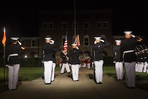 The United States Marine Corps Color Guard performs pass in review during the Evening Parade at Marine Barracks Washington, D.C., July 15, 2016. The guest of honor for the parade was the Honorable John Cornyn, United States Senator for Texas, and the hosting official was Gen. Robert Neller, commandant of the Marine Corps. (Official Marine Corps photo by Lance Cpl. Robert Knapp/Released)