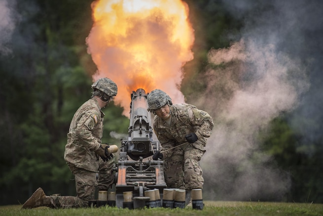 FIRE! U.S. Army Sgt. Ryan Skelton (left) of Denver, Co., and Staff Sgt. Elvis Servellon of Omaha, Neb. - both with the Fort Jackson Salute Battery - fire an M116 Howitzer during a retirement ceremony for Brig. Gen. Janice M. Haigler, deputy commanding general of the 335th Signal Command (Theater), at Fort Jackson, S.C., July 16, 2016. (U.S. Army photo by Staff Sgt. Ken Scar)