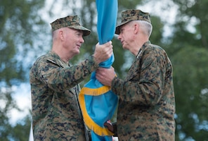 Marine Corps Gen. Joe Dunford, chairman of the Joint Chiefs of Staff, left, passes the U.S. Africa Command flag to Marine Corps Gen. Thomas D. Waldhauser, incoming commander of Africom, during the Africom change of command ceremony at U.S. Army Garrison Stuttgart, Germany, July 18, 2016. Waldhauser assumed command from Army Gen. David M. Rodriguez, who will retire after 40 years of military service. DoD photo by Navy Petty Officer 2nd Class Dominique A. Pineiro
