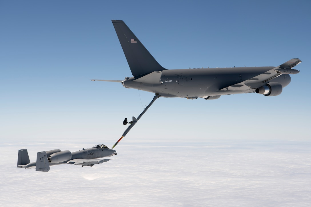 A KC-46 Pegasus refuels an A-10 Thunderbolt II with 1,500 pounds of fuel July 15, 2016. The mission was the last of all flight tests required for the tanker's Milestone C production decision. (Boeing photo/John D. Parker)