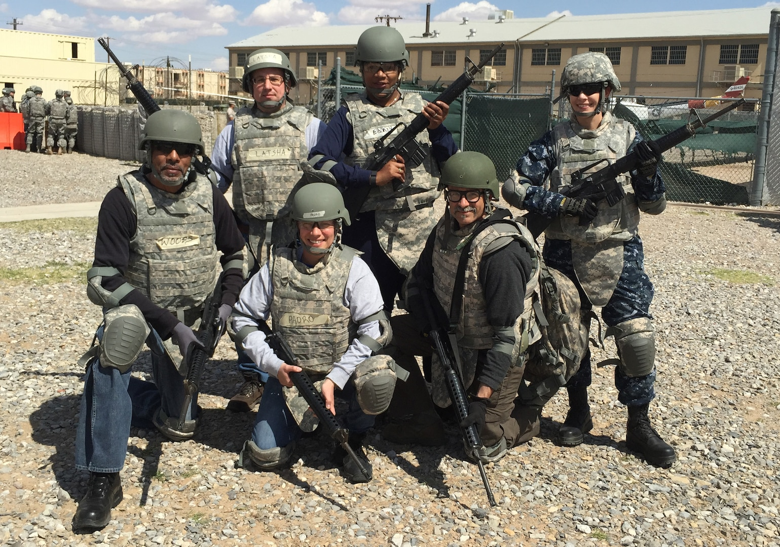 Navy Lt. j.g. Amy Aguirre (right), participated in Warrior Task Training with other Defense Contract Management Agency personnel at Operational Contract Support Joint Exercise 2015 held at Fort Bliss, Texas. Training consisted of convoy simulation, first aide, Humvee rollover training, room clearance and weapons qualification.
