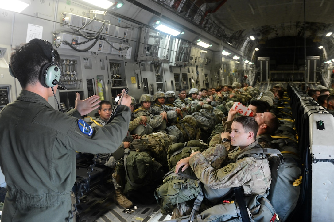 U.S. Air Force Staff Sgt. Donovan Eliopulos, 7th Airlift Squadron, briefs U.S. Army members from the 82nd Airborne Divison egress procedures on a C-17 Globemaster III aircraft from Joint Base Lewis-McChord, W.A., during Battalion Mass-Tactical week at Pope Army Airfield, N.C., July 12, 2016. During mass-tactical week the Army and Air Force units work together to improve interoperability for worldwide crisis, contingency and humanitarian operations. (U.S. Air Force photo by Staff Sgt. Sandra Welch)