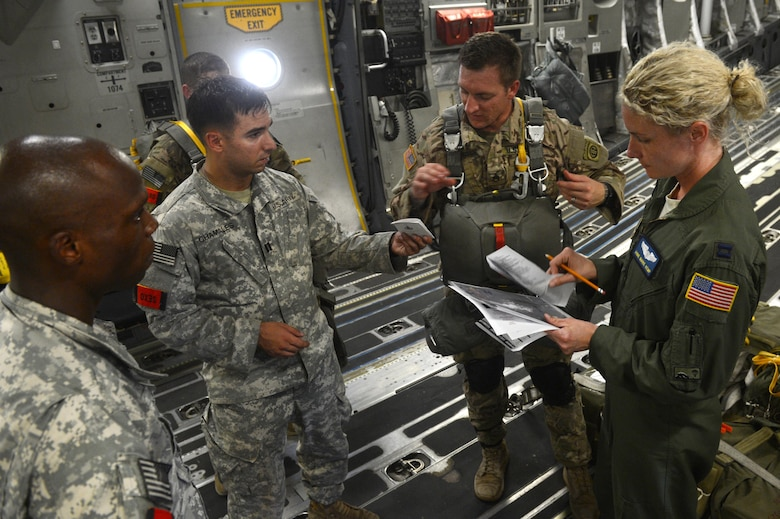 U.S. Air Force C-17 Globemaster III members from Joint Base Lewis-McChord, W.A., and U.S. Army members from the 82nd Airborne Division conduct a pre-mission brief before conducting static line drops on Sicily Drop Zone during Battalion Mass-Tactical week at Pope Army Airfield, N.C., July 12, 2016. During mass-tactical week the Army and Air Force units work together to improve interoperability for worldwide crisis, contingency and humanitarian operations. (U.S. Air Force photo by Staff Sgt. Sandra Welch)