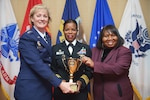 Defense Contract Management Agency director, Air Force Lt. Gen. Wendy Masiello, presents the Directors Cup to Navy Cmdr. Nicola Gathright, commander of DCMA Atlanta, and Vivian Hill, deputy director of DCMA Atlanta, at a Nov. 3 ceremony in Colonial Heights, Va.
