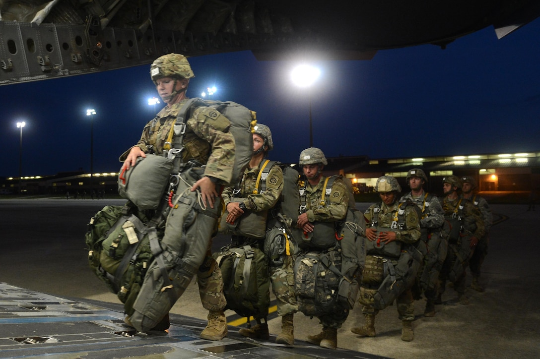 U.S. Army members from the 82nd Airborne Division load onto a C-17 Globemaster III aircraft from Joint Base Lewis-McChord, W.A., during Battalion Mass-Tactical week at Pope Army Airfield, N.C., July 12, 2016. During mass-tactical week the Army and Air Force units work together to improve interoperability for worldwide crisis, contingency and humanitarian operations. (U.S. Air Force photo by Staff Sgt. Sandra Welch)