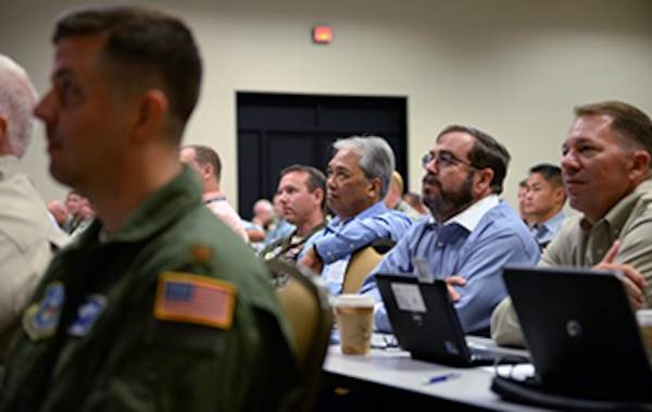Aircraft Operations personnel listen during a presentation at the Defense Contract Management Agency's annual Aircraft Operations Training Seminar at National Conference Center, August 18, in Leesburg, Va.