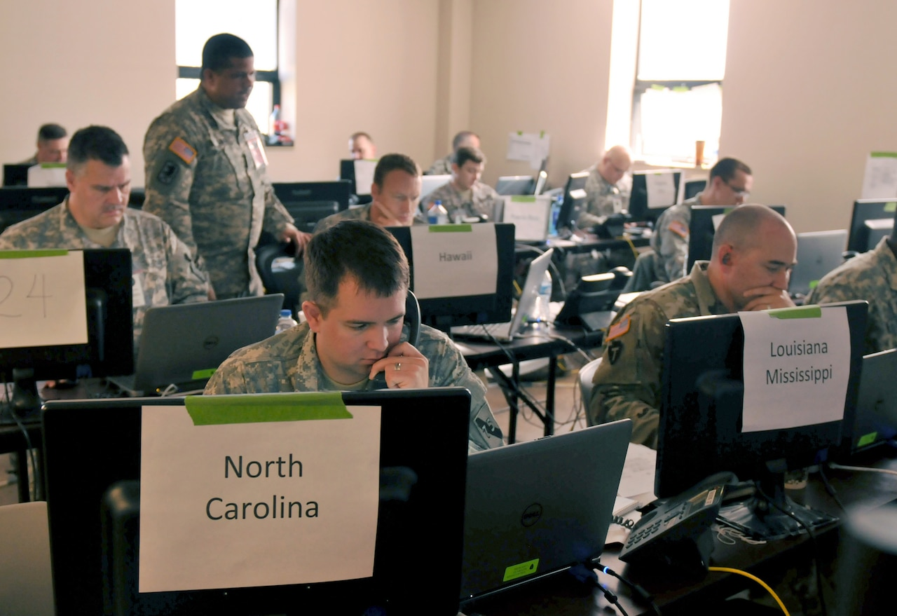 Today, finding and reacting to unknown flaws in software is entirely manual, as demonstrated by these assessment team members who are collecting data to analyze blue and red team attacks and defenses during exercise Cyber Shield 2016, at Camp Atterbury, Ind., April 28, 2016. On Aug. 4, 2016, the Defense Advanced Research Projects Agency will hold a Cyber Grand Challenge for seven finalist teams whose computers will compete autonomously in a capture the flag competition that eventually could make machine-speed cybersecurity around the world a reality. Army photo by Sgt. Stephanie A. Hargett