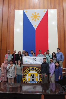 American and Filipino participants in the EMPOWER program meet members of the Dumaguete Effata Association of the Deaf, Philippine Federation of the Deaf, and Discovering Deaf Worlds, at the Damaguete City, Philippines, mayor's office. The visit was part of a professional exchange program designed to build capacity among the Filipino deaf community.