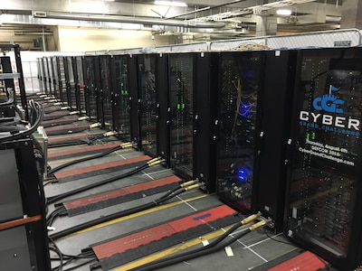 These racks, with cooling and power, will hold servers for the autonomous computer systems that will compete in the Defense Advanced Research Projects Agency's Cyber Grand Challenge finals in Las Vegas, Aug. 4, 2016. DARPA photo