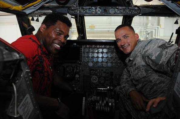Herschel Walker, a former NFL running back, and Staff Sgt. Matthew Lokitis, 96 Aircraft Maintenance Unit crew chief, sit on the flight deck of a B-52 Stratofortress at Barksdale Air Force Base, La., July 12, 2016. While on base, Walker received an up close look at the long-range bomber and learned about its devastating combat capabilities. (U.S. Air Force photo/Airman 1st Class Stuart Bright)