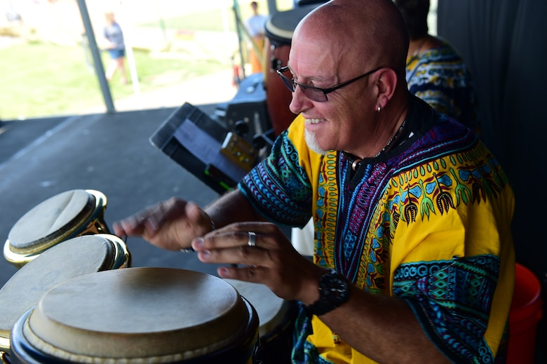 A drummer from the World Dance Show performs July 15, 2016, during Diversity Day on Buckley Air Force Base, Colo. Diversity Day provided an opportunity to explore and celebrate the accomplishments and cultures of a diverse military force, which included food, dancing and music from various cultures. (U.S. Air Force photo by Airman 1st Class Gabrielle Spradling/Released)