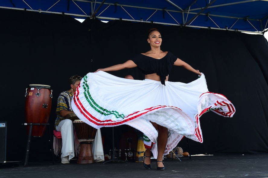 A member of the World Dance Show performs a routine July 15, 2016, during Diversity Day on Buckley Air Force Base, Colo. Diversity Day provided an opportunity to explore and celebrate the accomplishments and cultures of a diverse military force, which included food, dancing and music from various cultures. (U.S. Air Force photo by Airman 1st Class Gabrielle Spradling/Released)