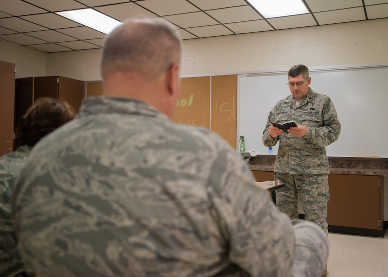 U.S. Air Force Chaplain Kerry Wentworth, of the 123rd Airlift Wing, Kentucky Air National Guard, leads a religious service for military members at Carlisle County High School in Bardwell, Ky., July 17, 2016, during the Bluegrass Medical Innovative Readiness Training. The program will offer medical and dental care at no cost to residents in three Western Kentucky locations from July 18 to 27.(U.S. Air National Guard photo by Master Sgt. Phil Speck)