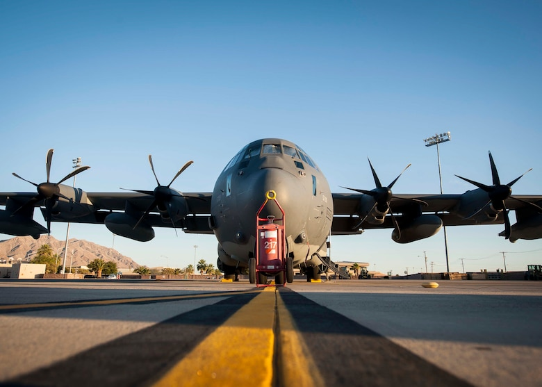 An HC-130 from Davis-Monthan Air Force Base, Arizona, sits idly on the Nellis flightline before preparing to take-off for a training sortie during Red Flag 16-3 July 13. With the HC-130 providing transport to the 79th Rescue Squadron during the exercise, the aircraft is able to deliver the RQS airman to the destination during the exercises while also being able to perform supply drops into the field. (U.S. Air Force photo by Senior Airman Jake Carter)