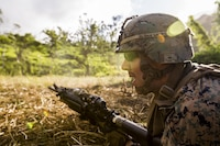 U.S. Marine Lance Cpl. Nathan H. Steed with Task Force Koa Moana 16.2 fires rounds down range while conducting integrated fire-team buddy rushes with Soldiers from the Republic of Fiji Military Forces on Ovalau, Fiji, July 13, 2016. Fiji is part of Task Force Koa Moana's deployment throughout the Asia- Pacific region, where Marines and Sailors will share engineering and infantry skills with the RFMF to strengthen mil-to-mil relationships and interoperability.