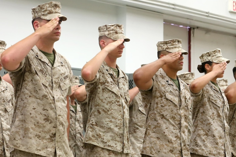 NAVAL SUPPORT FACILITY INDIAN HEAD, MD -- Marines and sailors with Headquarters and Service Company, Chemical Biological Incident Response Force, CBIRF, render a salute during a change of command ceremony at Naval Support Facility Indian Head, Md., July 13, 2016. Capt. Robert G. Ukrainec assumed command from Capt. Lucas H. Forcella, and the two gave remarks during the ceremony thanking their leadership and families. (Official USMC Photo by Sgt. Jonathan S. Herrera/Released)
