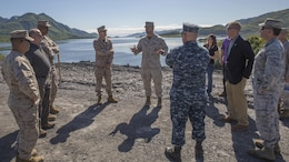 Gunnery Sgt. Brandon Watson (center), project coordinator for Innovative Readiness Training Old Harbor, Alaska, briefs a group of distinguished visitors from different military branches and civilian agencies July 11, 2016. IRT Old Harbor is part of a civil and joint military program to improve military readiness while simultaneously providing quality services to underserved communities throughout the United States.