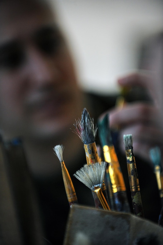 """Healing America's Heroes through the Power of the Arts"" Detail shot of art brushes as Marine Staff Sgt. Anthony Mannino performs Art Therapy as part of his Traumatic Brain Injury (TBI) treatment and recovery.  Staff Sgt. Mannino receives art and music therapy at the National Intrepid Center of Excellence, Walter Reed National Military Medical Center located in Bethesda, Maryland.  (Department of Defense photo by Marvin Lynchard)"